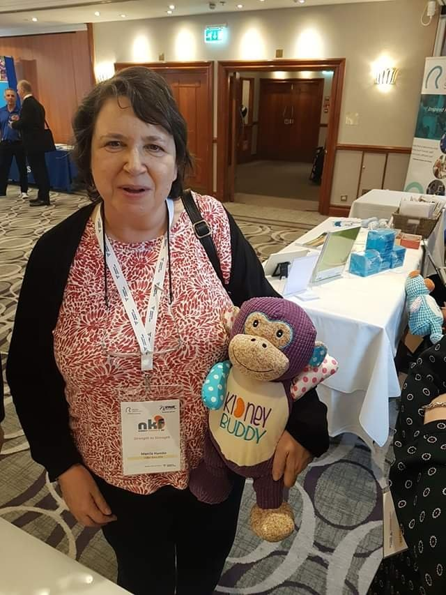 Marcia pictured with a kidney buddy monkey teddy at a kidney disease event.
