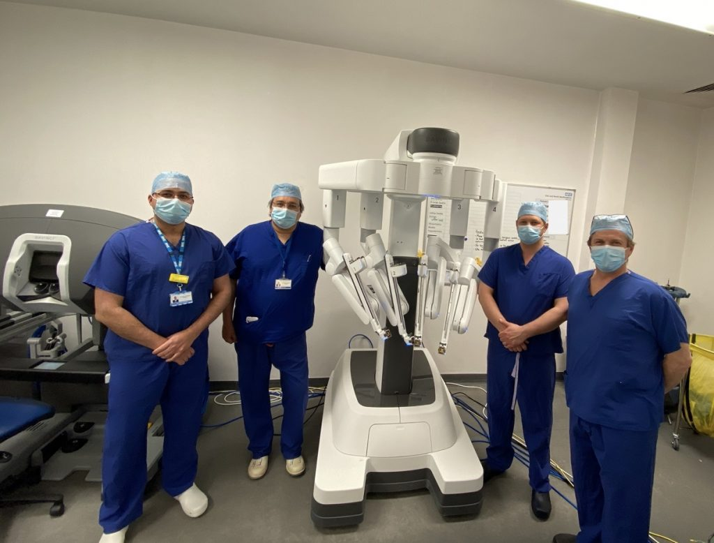 Urology consultants Mr Nikhil Vasdev, Mr Tim Lane, Mr Ben Pullar and Mr Jim Adshead, pictured next to the robot they have all been using for operations
