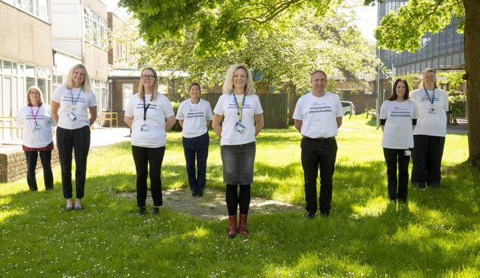 The picture shows East and North Hertfordshire NHS Trust's 'How are you doing' team in their branded T-shirts, who have received regional recognition in this year's NHS Parliamentary Awards, one of two teams in the trust who jointly won the Wellbeing at Work Award.