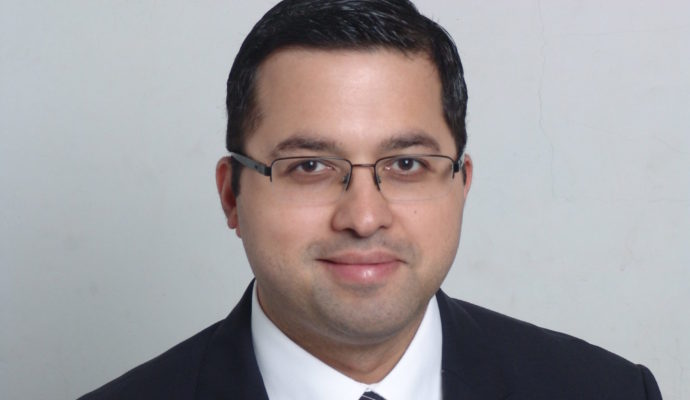 Portrait of Nikhil Vasdev, associate medical director for cancer services and a consultant urologist surgeon at East and North Hertfordshire NHS Trust,